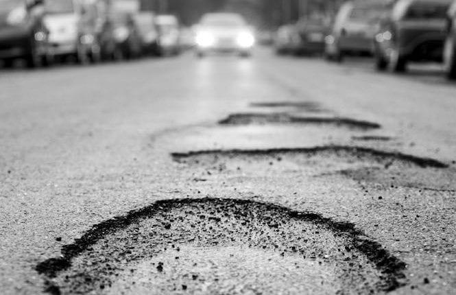 Pothole, black and white – selective focus