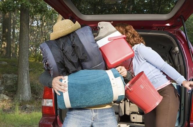 Couple unpacking car